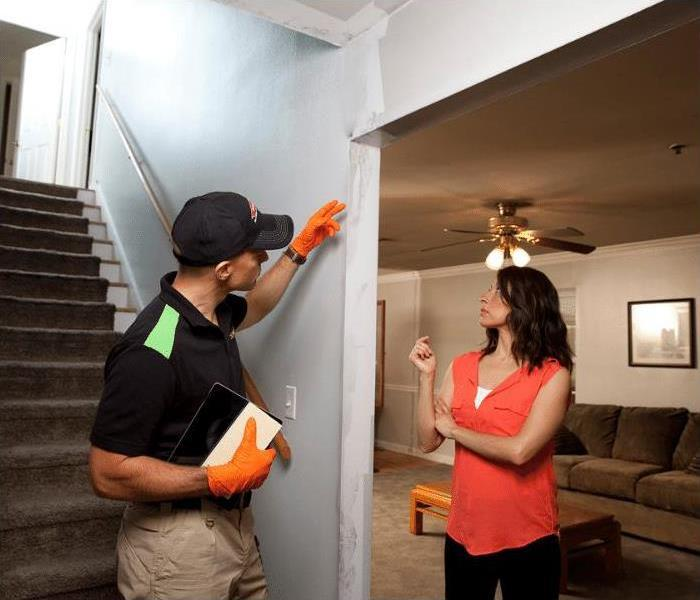 SERVPRO is the restoration company for you in St. Petersburg - image of technician and customer in home
